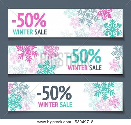 Three winter sales banners with snowflakes.