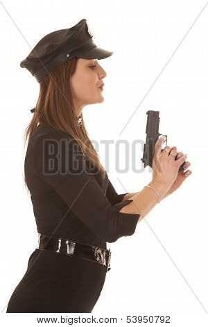 Woman Cop Blowing On Pistol