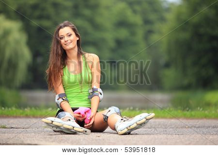 Woman Roller Skating Sport Activity In Park