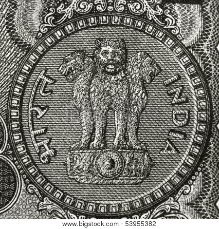 One rupee symbol on the back side of rupee note