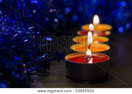 A Row From Burning Candles And A Christmas Decor
