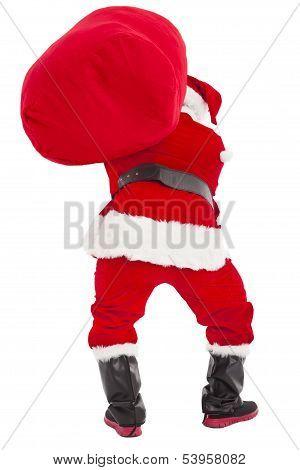 Santa Claus Carrying Heavy Gift Bag