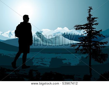 backpacker enjoying of a mountain valley view