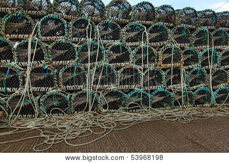 Lobster Or Crayfish Pots Stacked On Fishing Boat