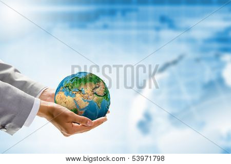 Image of Earth planet in human hands. Protect planet.