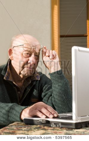 Senior Man And Laptop