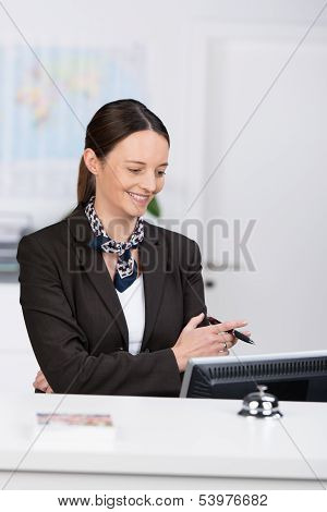 Stylish Receptionist Reading Data On Her Computer