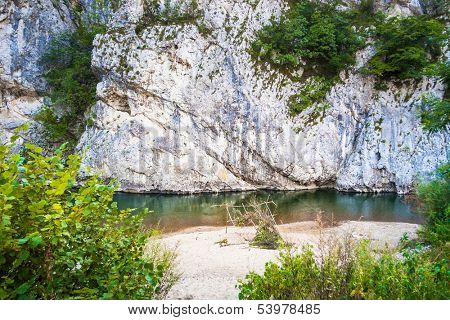 small paradise with river sand and rocks