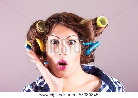 Attractive girl with curlers
