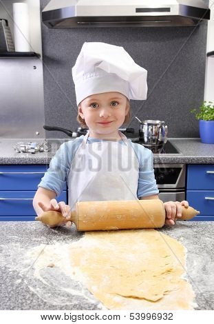 Little girl baking cakes