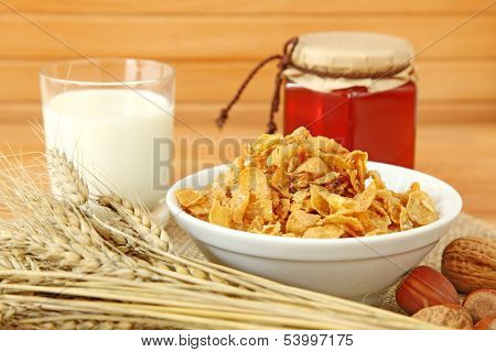 Muesli in bowl with nuts,milk and honey