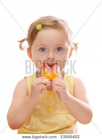 Little girl eating colorful ice lolly isolated on white background