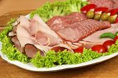 picture of smoked ham  - Party banquet plate with cold cuts of polish ham and sausage - JPG