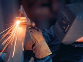 pic of slag  - Welder using an acetylene torch to cut through a piece of metal - JPG