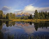 image of mountain-range  - the grand teton mountain range reflecting in a beaver pond at schwabackers landing in grand teton national park located in wyoming - JPG