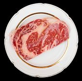 foto of wagyu  - Premium quality kobe beef ribeye steak in plate isolated on black with clipping path - JPG