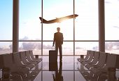 image of acceleration  - businessman in airport and airplane in sky - JPG