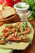 image of hardtack  - Sandwiches with vegetables and greens on plate on wooden table close - JPG