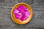picture of wild-brier  - wild rose brier fresh petal for tea in wooden plate - JPG