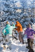 stock photo of snowball-fight  - Snowball fight winter friends having fun playing in snow outdoors - JPG