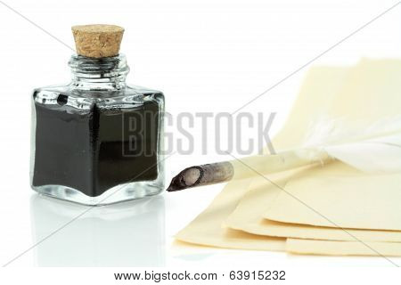 Quill pen in glass ink bottle