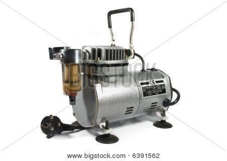 Metal Shiny Air Compressor Isolated On White Background.