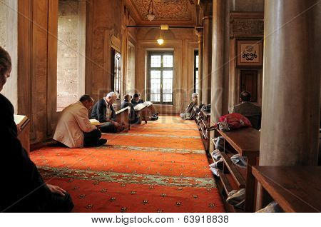 Muslim Men Reading The Holy Quran