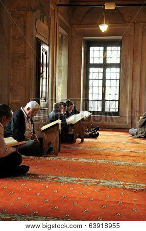 Muslim Men Reading The Holy Quran