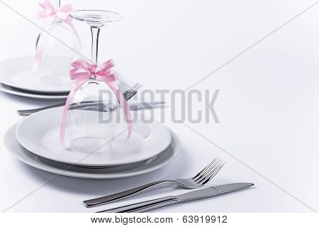 Festive Table Set With Glasses And Silverware On White Background Horizontal