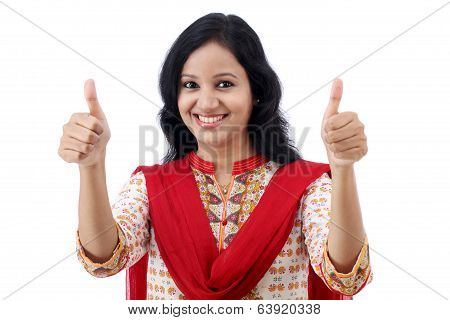 Happy Young Womanmaking Thumbs Up Sign