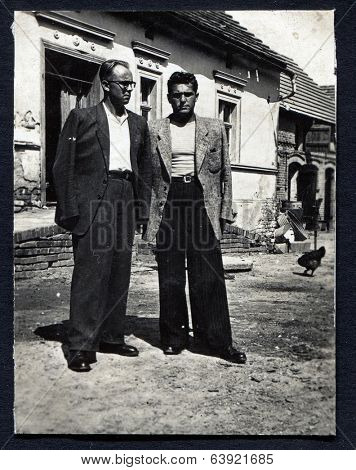 POLAND, CIRCA 1948: Brothers posing for the photograph in Lubsko (scratches and dust), circa 1948