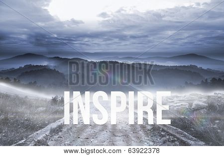 The word inspire against stony path leading to large misty mountains