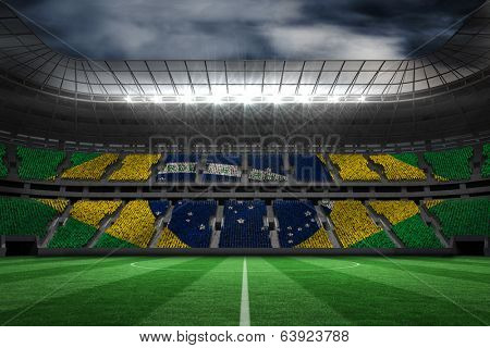 Digitally generated brazilian national flag against large football stadium