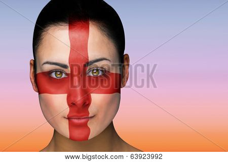 Composite image of beautiful brunette in england facepaint against beautiful orange and blue sky