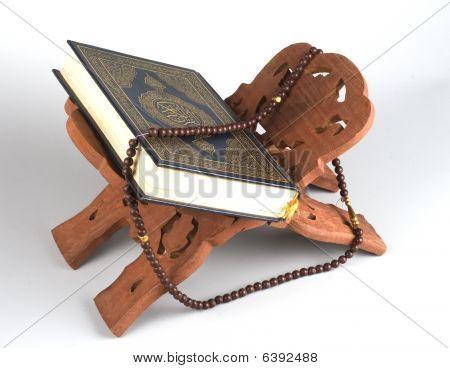 Holy islamic book Koran closed with rosary