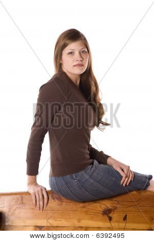 Woman On Back Of Bench Serious