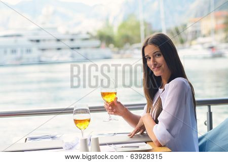 young woman have fresh healthy salad meal lunch at restaurant