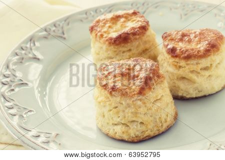 Homemade buttermilk tea biscuits on a pretty antique plate.