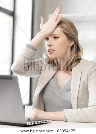 business and technology concept - picture of stressed woman with laptop computer