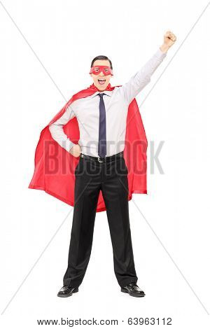 Full length portrait of a superhero with raised fist isolated on white background