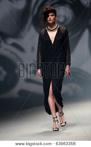 Fashion model wears clothes made by Tatjana Pantos on