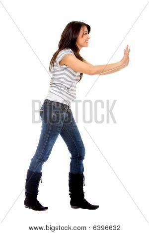 Woman Pushing Something
