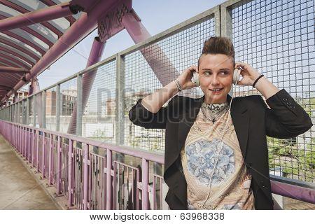 Pretty Short Hair Girl Listening To Music On A Bridge
