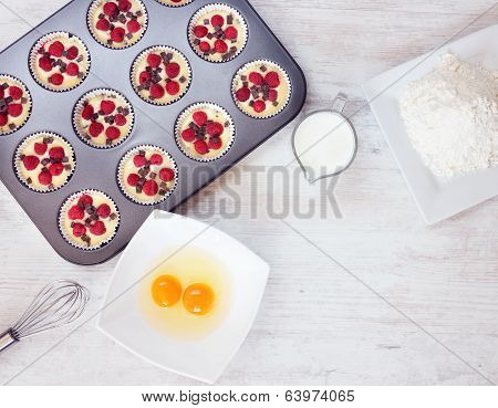 Top View Of Unripe Muffins With Ingredients