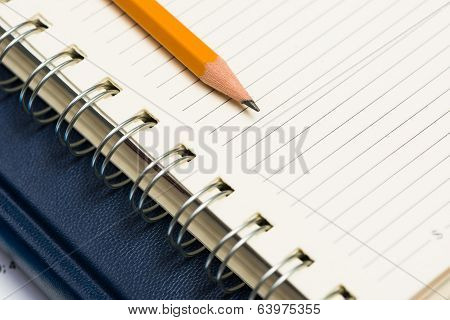 notebooks and pencil on the desk