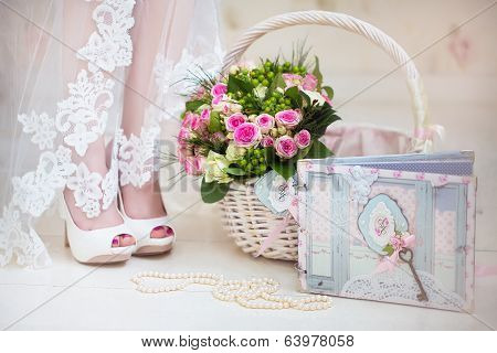 The bride on her wedding day. Morning bride. Wedding accessories. Wedding bouquet into basket. Strin