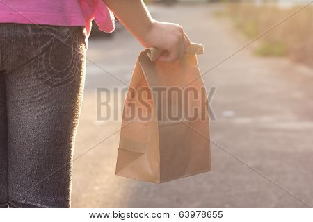 Child Walking To School, With Lunch Bag
