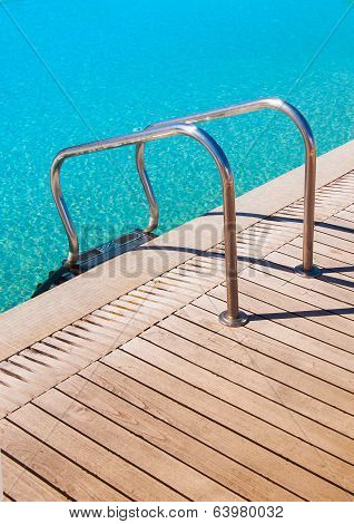 Metal Railings In The Pool Near The Wooden Flooring