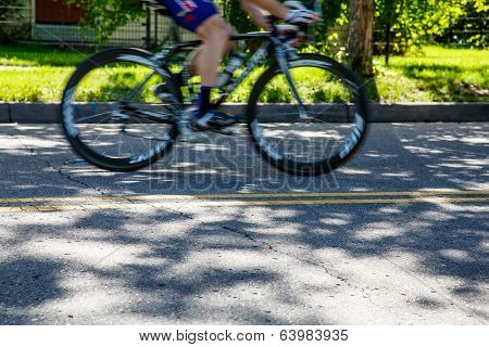 Bicycle Racing Down Residential Street