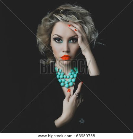 Beautiful Blonde With Bright Makeup And Jewelry